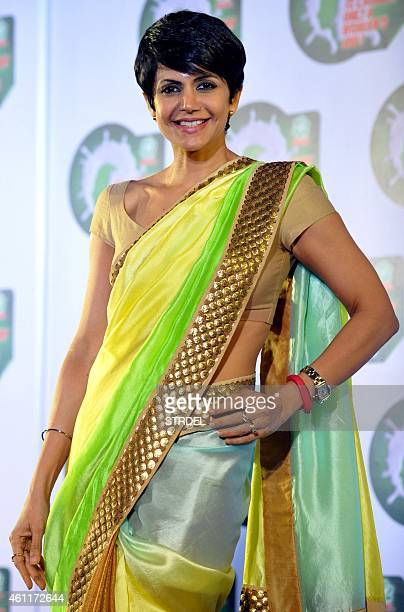 Indian Bollywood actress Mandira Bedi poses for a photograph during a promotional event in Mumbai on January 8 2015 AFP PHOTO / STR