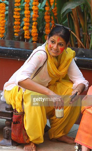 Indian Bollywood actress Nandita Das celebrates Holi the 'festival of colours' in Mumbai on March 6 2015 AFP PHOTO