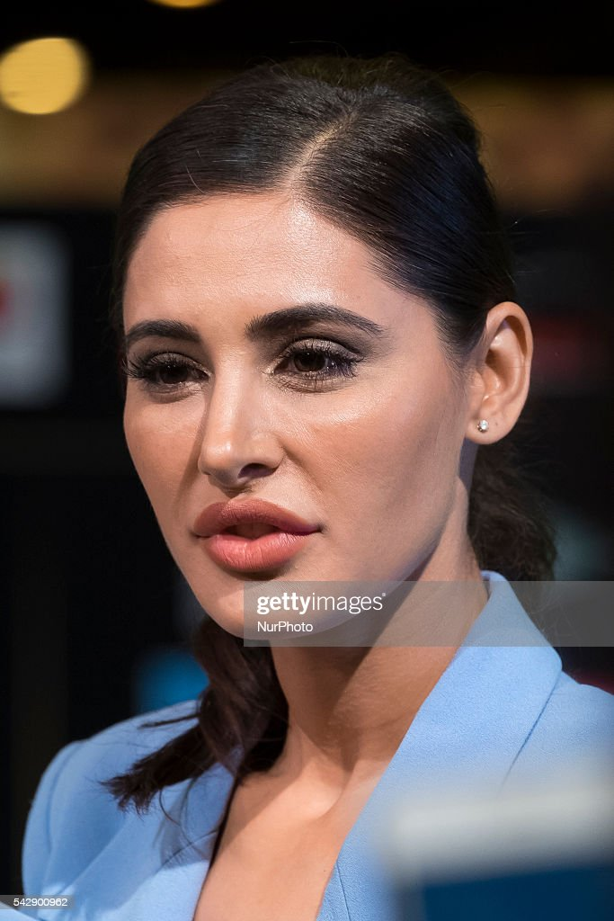 Indian Bollywood actress <a gi-track='captionPersonalityLinkClicked' href=/galleries/search?phrase=Nargis+Fakhri&family=editorial&specificpeople=7417642 ng-click='$event.stopPropagation()'>Nargis Fakhri</a> poses on the green carpet as she arrives to the 17th edition of IIFA Awards (International Indian Film Academy Awards) in Madrid on June 24, 2016.