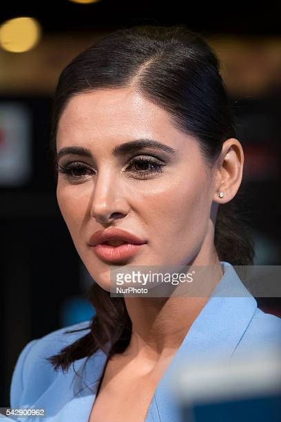 Indian Bollywood actress Nargis Fakhri poses on the green carpet as she arrives to the 17th edition of IIFA Awards in Madrid on June 24 2016