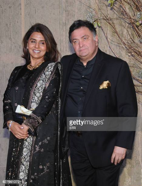 Indian Bollywood actress Neetu Singh and her husband Rishi Kapoor pose for a photograph during designer Manish Malhotra's 50th birthday in Mumbai on...