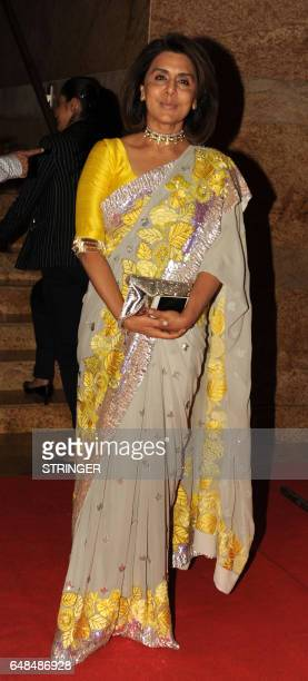 Indian Bollywood actress Neetu Singh attends the fundraiser Mijwan 2017 fashion show in Mumbai on March 5 2017 / AFP PHOTO / STRINGER