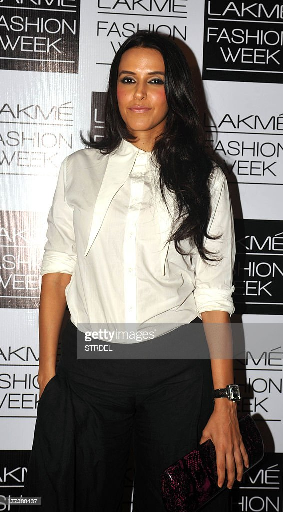 Indian Bollywood actress <a gi-track='captionPersonalityLinkClicked' href=/galleries/search?phrase=Neha+Dhupia&family=editorial&specificpeople=2195000 ng-click='$event.stopPropagation()'>Neha Dhupia</a> attends the Lakme Fashion Week (LFW) Winter/Festival 2013 in Mumbai on August 22, 2013.