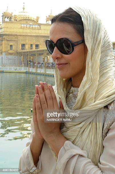 Indian Bollywood actress Neha Dhupia poses for a photograph at the Golden Temple in Amritsar on October 72014 Dhupia visited the city during...