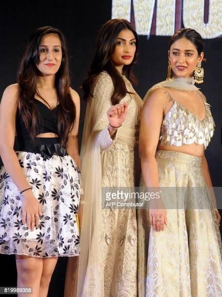 Indian Bollywood actress Neha Sharma Athiya Shetty and Ileana DCruz attend a promotional event for their upcoming Hindi film 'Mubarakan' in Mumbai on...