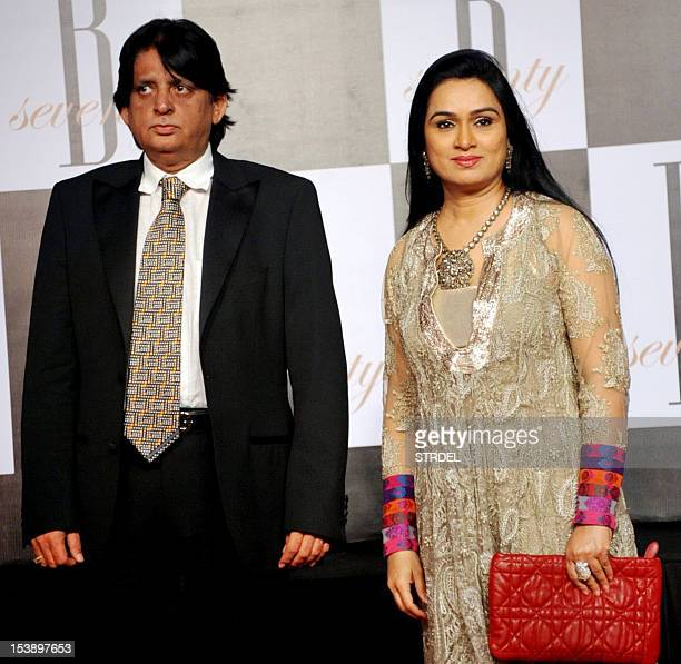 Indian Bollywood actress Padmini Kolhapure poses with her husband Pradeep Sharma as they attend the 70th Birthday celebrations of Bollywood Actor...