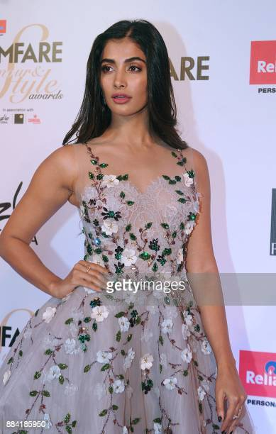 Indian Bollywood actress Pooja Hegde poses for a photograph during the Filmfare Glamour Style Awards 2017 in Mumbai on December 1 2017 / AFP PHOTO /