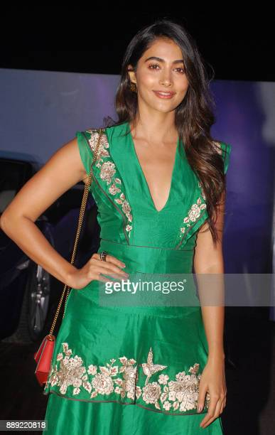 Indian Bollywood actress Pooja Hegde poses for a picture at the screening of 'The grand tour season 2' in Mumbai late on December 9 2017 / AFP PHOTO /