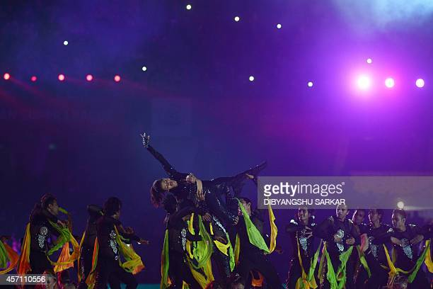 Indian Bollywood actress Priyanka Chopra performs with dancers during the inauguration of the Indian Super League football tournament in Kolkata on...