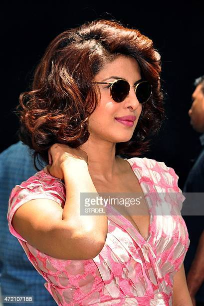 Indian Bollywood actress Priyanka Chopra poses as she arrives to attend a special brunch and promotion for the forthcoming Hindi film Dil Dhadakne Do...