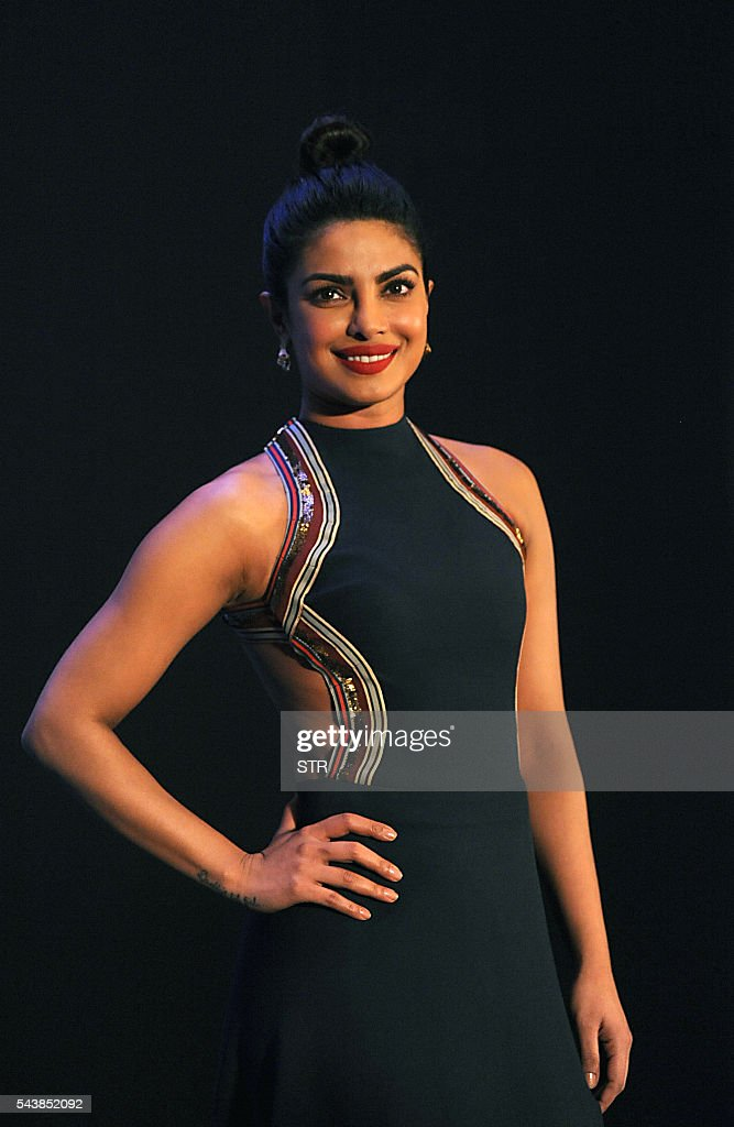 Indian Bollywood actress Priyanka Chopra poses during a promotional event for Maxim India in Mumbai on June 30, 2016. / AFP / STR