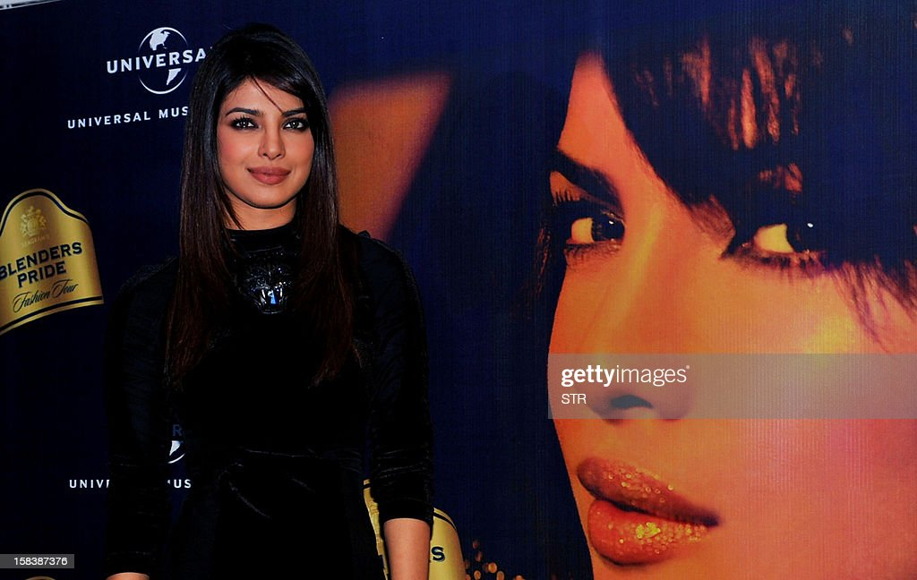 Indian Bollywood actress Priyanka Chopra poses for a photo during a press conference for Blender's Pride Fashion Tour in Mumbai on December 14, 2012.