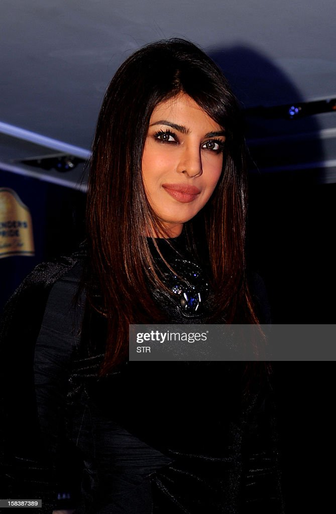 Indian Bollywood actress Priyanka Chopra poses for a photo during a press conference for Blender's Pride Fashion Tour in Mumbai on December 14, 2012. AFP PHOTO/ STR