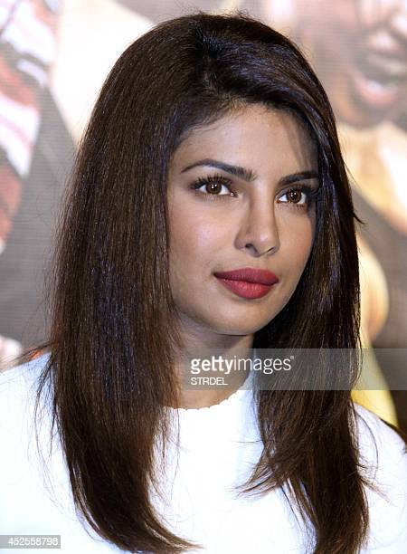 Indian Bollywood actress Priyanka Chopra poses for a photograph during a promotional event for the forthcoming Hindi film 'Mary Kom' directed by...