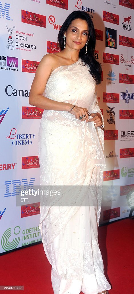 Indian Bollywood actress Rajeshwari Sachdev poses for a photograph during the 'Kashish Mumbai International Queer Film Festival 2016', South Asia's biggest LGBT film festival in Mumbai on late May 25, 2016. / AFP / STR