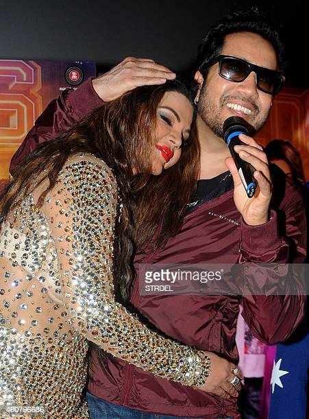 Indian Bollywood actress Rakhi Sawant with singer Mika Singh during the launch of the song 'Awesome Mera Chumma' for Hindi film 'Mumbai Can Dance...