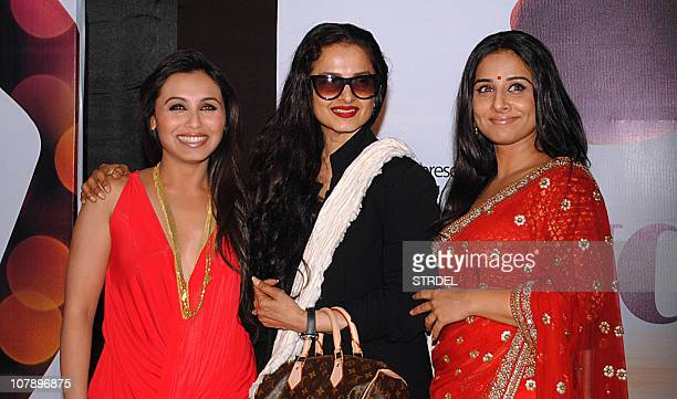 Indian Bollywood actress Rani Mukerji Rekha and Vidya Balan pose for the camera as they attend the premiere of the Bollywood hindi film 'No One...
