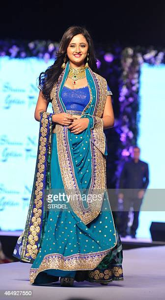 Indian Bollywood actress Rashmi Desai poses during the tenth annual Caring with Style fashion show in association with The Cancer Patients Aid...