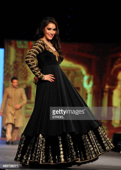 Indian Bollywood Actress Rashmi Nigam Displays A Creation By Designer Vikram Phadnis During A