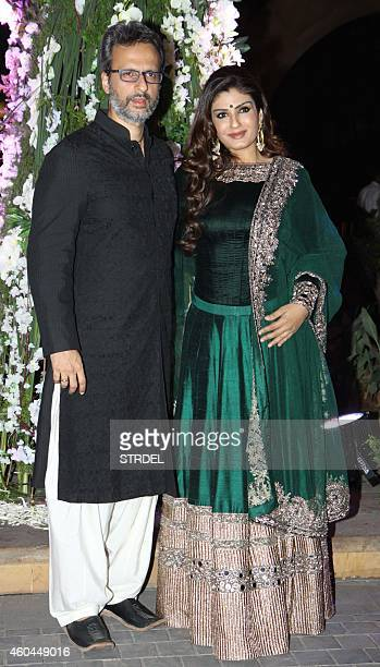 Indian Bollywood actress Raveena Tandon and husband Anil Thadani attend the marriage Sangeet ceremony of Bollywood film director Punit Malhotra and...