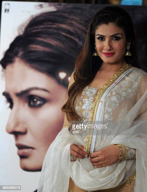 Indian Bollywood actress Raveena Tandon poses ahead of addressing a press conference on her Hindi film Maatr in Mumbai on April 17 2017 / AFP PHOTO /...