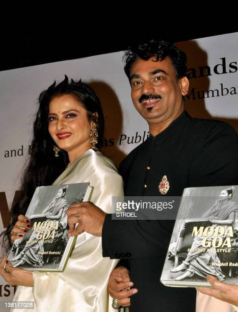 Indian Bollywood actress Rekha and designer Wendell Rodricks attend the 'Mada Goa' book launch in Mumbai on February 3 2012 AFP PHOTO/STR
