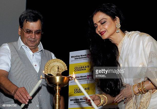 Indian Bollywood actress Rekha and film director Subhash Ghai light a ceremonial lamp during the inauguration of the Internationals Celebration...