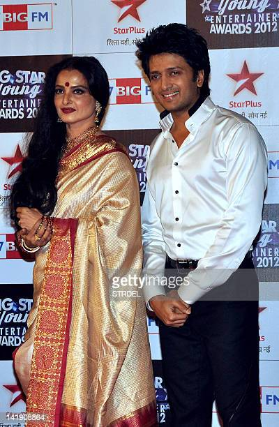 Indian Bollywood actress Rekha and Ritesh Deshmukh pose on the red carpet of the Big Star Young Entertainer Awards ceremony in Mumbai on March 25...