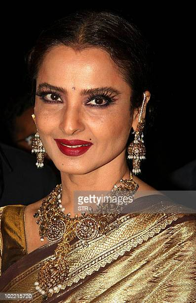 Indian Bollywood actress Rekha attends the launch of photographer Gautam Rajadhyaksh�s Marathi coffee table book �Chehere� in Mumbai on June 18 2010...