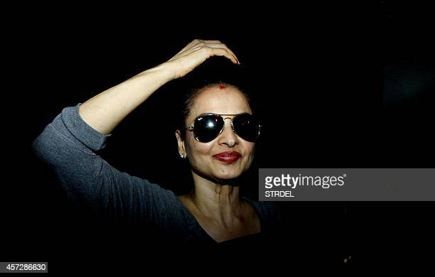 Indian Bollywood actress Rekha looks on as she leaves after taking part in production for the forthcoming Hindi film 'Super Nani' directed by Indra...
