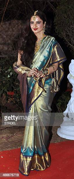 Indian Bollywood actress Rekha poses as she attends the wedding reception of actress Ahana Deol and husband Vaibhav Vohra in Mumbai on February 2...