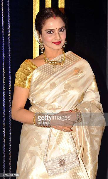 Indian Bollywood actress Rekha poses during the 64th birthday celebrations for Indian Bollywood director Rakesh Roshan in Mumbai on September 6 2013...