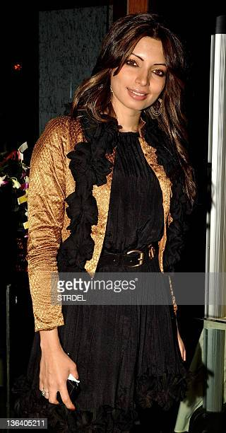 Indian Bollywood actress Rekha poses during the launch of Mohini Chabria's new restaurant in Mumbai on January 3 2012 AFP PHOTO/STR