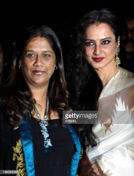 Indian Bollywood actress Rekha poses with Mohini Chabria during the inauguration of the restaurant 'Mangiamo' in Mumbai late January 3 2012 AFP...