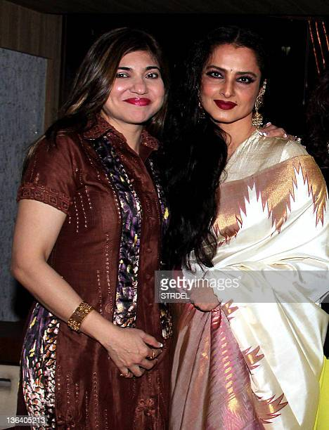 Indian Bollywood actress Rekha poses with play back singer Alka Yagnik during the launch of Mohini Chabria's new restaurant in Mumbai on January 3...