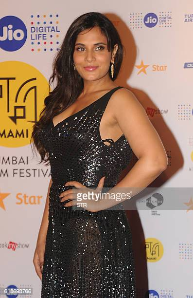 Indian Bollywood actress Richa Chadda poses for a photograph at the closing ceremony of the 18th Mumbai Film Festival in Mumbai on late October 27...