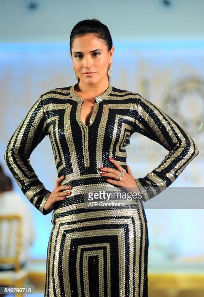 Indian Bollywood actress Richa Chadda showcases a creation during the Joya Fashion and Lifestyle Exhibition fashion show in Mumbai on late September...