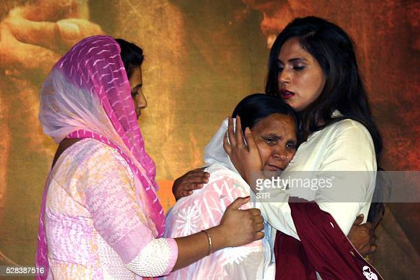Indian Bollywood actress Richa Chaddacomforts the daughter Poonam Kaur and wife Sukhpreet Kaurof Sarabjit Singh during the promotion of the Hindi...