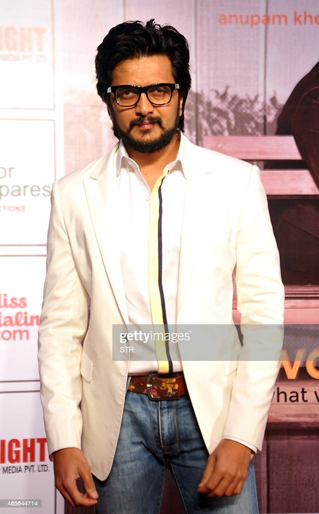 Indian Bollywood actress <a gi-track='captionPersonalityLinkClicked' href=/galleries/search?phrase=Ritesh+Deshmukh&family=editorial&specificpeople=4141905 ng-click='$event.stopPropagation()'>Ritesh Deshmukh</a> attends the new Hindi stage play 'Mera Woh Matlab Nahi Tha, written and directed by Rakesh Bedi, in Mumbai on March 8, 2015. AFP PHOTO