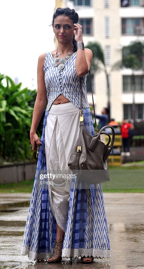 Indian Bollywood actress Roshani Chopra poses during the Lakme Fashion Week (LFW) Winter/Festival 2014 in Mumbai on August 22, 2014.