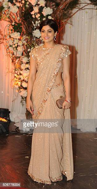 Indian Bollywood actress Samita Shetty poses as she attends a reception after the wedding of fellow thespians Bipasha Basu and Karan Singh Grover in...