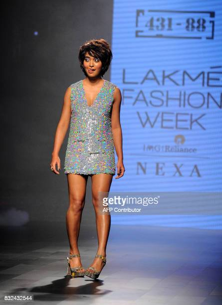 Indian Bollywood actress Sayani Gupta showcases a creation by designer Shweta Kapur at Lakme Fashion Week Winter/Festive 2017 in Mumbai on August 16...