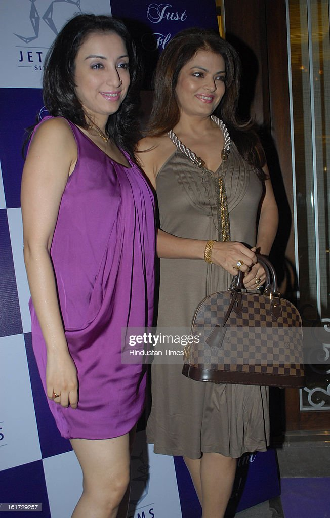 Indian bollywood actress Sheeba with Madhurima Nigam (L) during the launch of Pradeep Jethani's flagship store 'Jet Gems' at Turner Road, Bandra on February 13, 2013 in Mumbai, India.