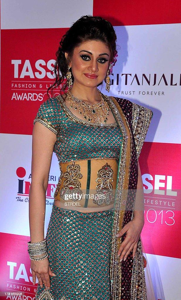 Indian Bollywood actress Shefali Zariwala poses during the Tassel Fashion and Lifestyle Awards 2013 in Mumbai late July 8, 2013. AFP PHOTO/STR