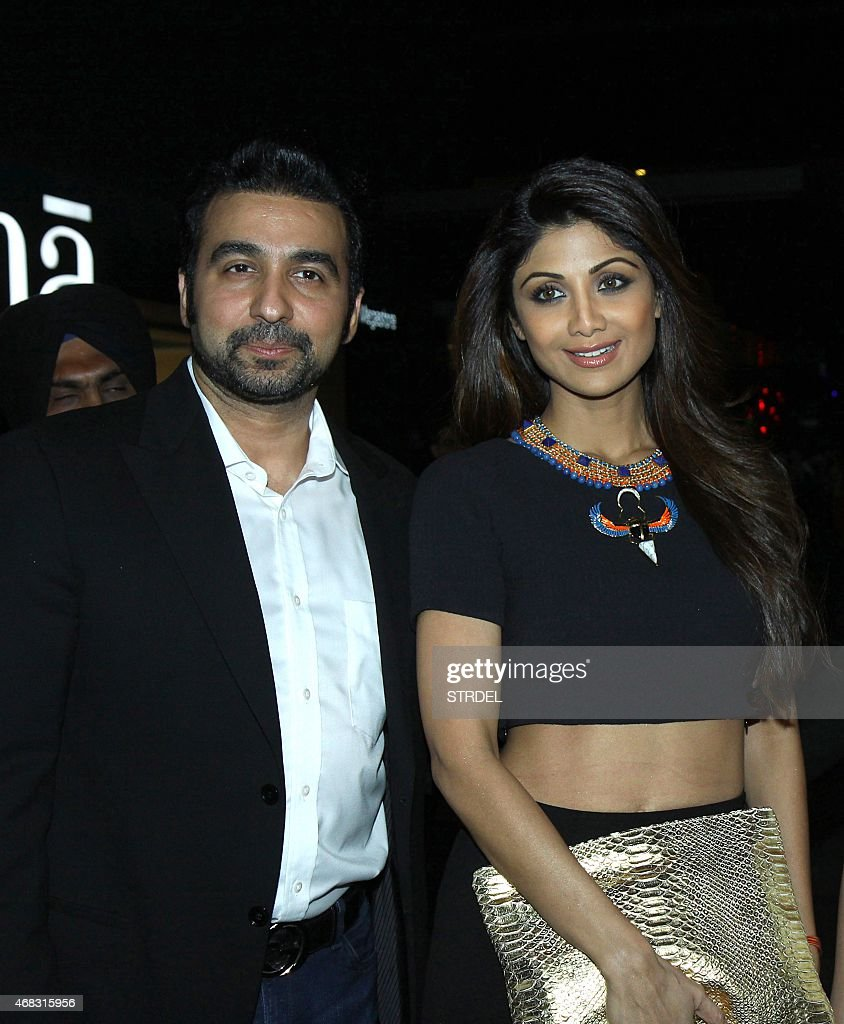 Indian Bollywood actress <a gi-track='captionPersonalityLinkClicked' href=/galleries/search?phrase=Shilpa+Shetty&family=editorial&specificpeople=565509 ng-click='$event.stopPropagation()'>Shilpa Shetty</a> (R) poses poses with her husband <a gi-track='captionPersonalityLinkClicked' href=/galleries/search?phrase=Raj+Kundra&family=editorial&specificpeople=5294666 ng-click='$event.stopPropagation()'>Raj Kundra</a> as they attend the Indian premiere of the Hollywood film 'Fast & Furious 7' in Mumbai late April 1, 2015. The Hollywood film which was released in the US, will be available in four languages for Indian audiences, English, Hindi, Tamil and Telugu. AFP PHOTO/STR
