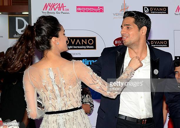 Indian Bollywood actress Shraddha Kapoor and Siddharth Malhotra share a light moment as they attend the HT Mumbai's Most Stylish Awards 2015 ceremony...
