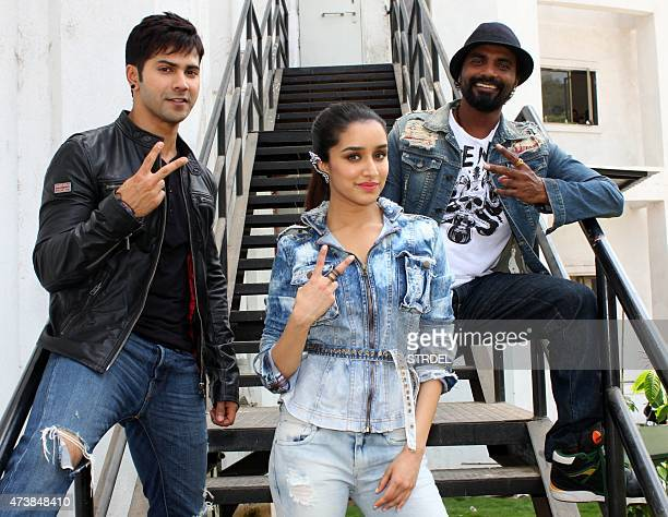 Indian Bollywood actress Shraddha Kapoor poses with actors Varun Dhawan and director Remo DSouza during a promotional event for the forthcoming Hindi...