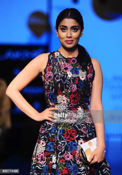 Indian Bollywood actress Shriya Saran poses for a photograph during the Lakme Fashion Week Winter/Festive 2017 in Mumbai on August 20 2017 Lakme...