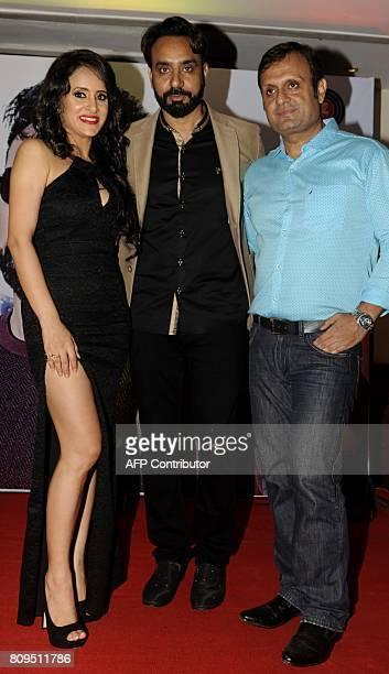 Indian Bollywood actress Shweta Khanduri and Punjabi singer Babbu Maan pose for a photograph during a promotional event for Hindi music album...