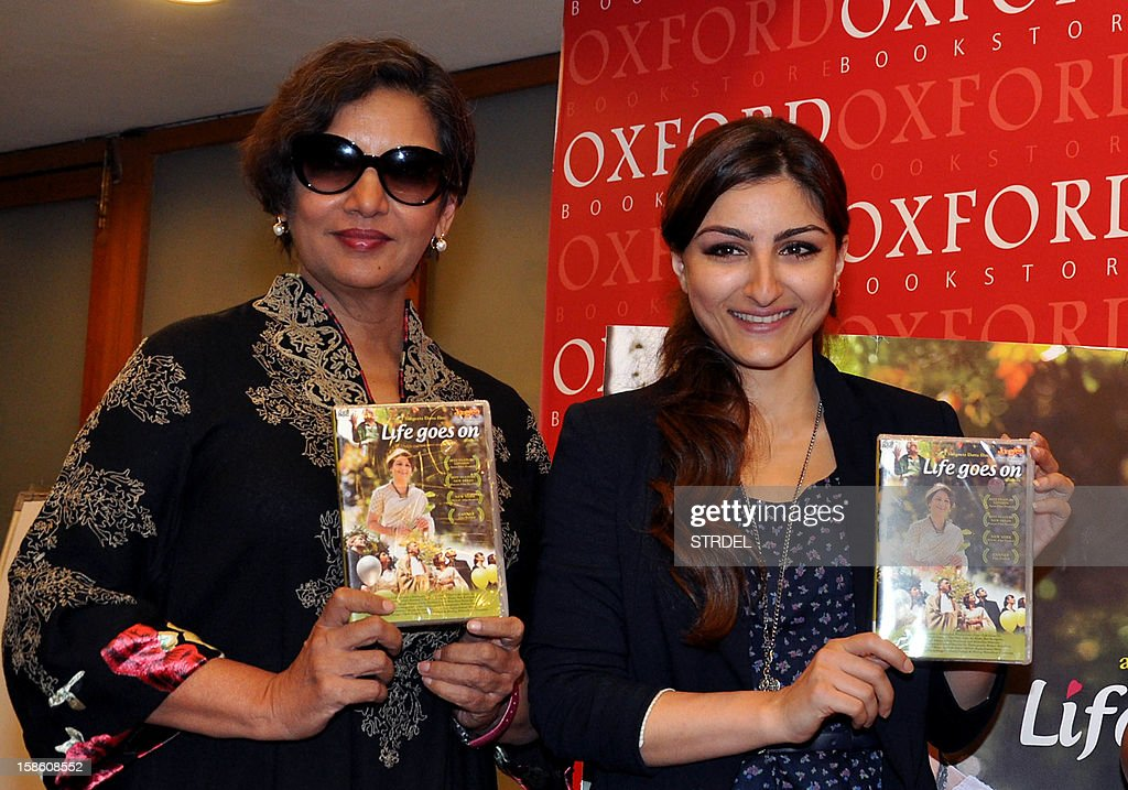 Indian Bollywood actress Soha Ali Khan (R) and Shabana Azmi (L) poses during the DVD launch of film Life Goes On in Mumbai on December, 20 2012.